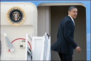 President Barack Obama on Tuesday boards Air Force One at Andrews Air Force Base, Md., enroute to Florida.
