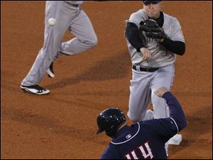 Louisville second baseman Chris Valaika outs Toledo's Brad Eldred on this double play.