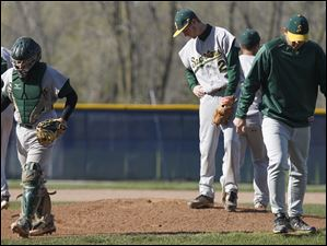 Spartans pitcher Austin Suiter (2) stays on the mound after a team conference.