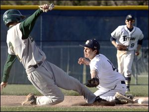 Start's Austin Suiter is tagged out at second base by St. Johns'  Mike Eddingfield.