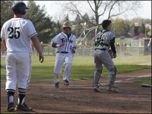 St. John's Titans batters, from left Nate Pearson, Jimmy Scott, and Joe Robie score on a double while Start catcher Jake Cannon waits for the ball that never came.
