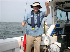 David Mustine, former ODNR director, displays a Lake Erie walleye he caught aboard Sea Breeze Sixteen last summer during the 33rd annual Governor's Fish Ohio Day promotion at Port Clinton.