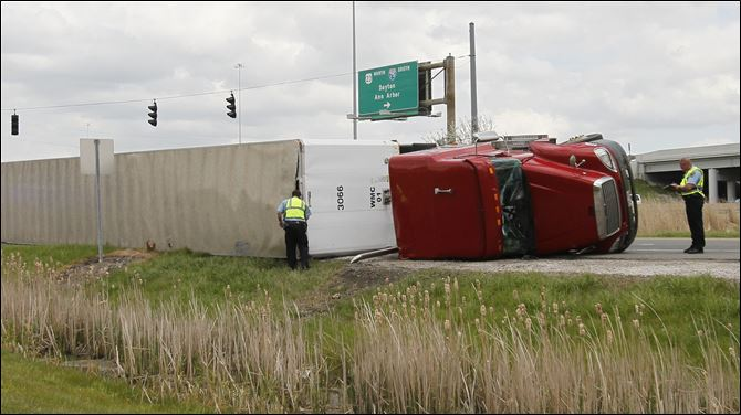 An overturned tractor trailer blocks the on ramp to southbound I-75 in Perrysburg on Monday after a single vehicle accident.