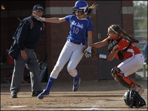 Springfield's Kiley Aller is tagged out at the plate by Southview catcher Jess Knepper.