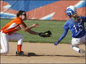 Southview's Bri Michel tags out Springfield's Ashley Zappone at second base.