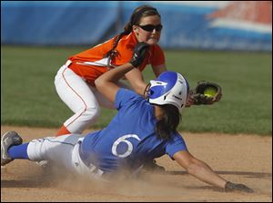 Southview's Bri Michel tags out Springfield's Hannah Girlie at second base.