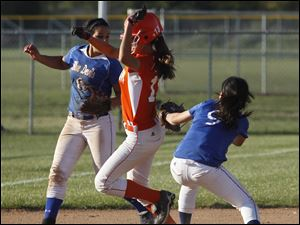 Springfield's Bre Espino misses the tag on Southview's Rachel Loch in the top of the seventh inning. Watching is Springfield's Hannah Girlie.