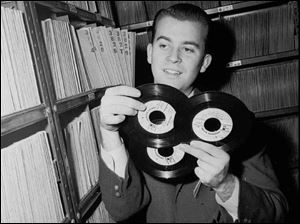 In this Feb. 3, 1959 file photo, Dick Clark selects a record in his station library in Philadelphia.
