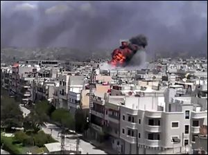 Amateur video shows an explosion amid heavy shelling in the Khaldiyeh area of Homs, Syria.
