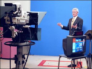 Stan Stachak presents the 5 p.m. forecast in 1997.