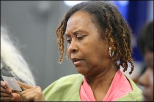 Linda Carter, waiting at the Providence Center, doesn't mince words: 'We need food, or we wouldn't be here.'
