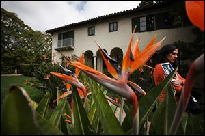 Bird of Paradise blooms frame a front yard view of the Winter House, built in 1925, an 'old world' Mediterranean estate designed by architect Ray J. Kieffer. The home in Beverly Hills, California, is on the market for the first time in 87 years.