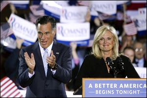 Republican presidential candidate, former Massachusetts Gov. Mitt Romney, left, and his wife, Ann, take the stage at an election night rally in Manchester, N.H., Tuesday.