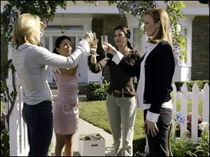 "From left, Felicity Huffman, Eva Longoria, Teri Hatcher and Marcia Cross toasting one another in a scene from ABC's ""Desperate Housewives."""