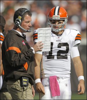 Colt McCoy consults with coach Pat Shurmur during a game last season. McCoy has been 6-15 as the Browns' starter the last two seasons, but his reign as starter appears to be over in Cleveland with the drafting of Brandon Weeden.