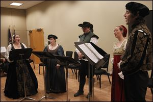 From left: Natalie Emptage, Lauren and Christopher Krieger, Heather Hamilton and Gyuri Barabas sing during An Evening with Shakespeare at the Bedford Branch Library in Temperance, Mich.
