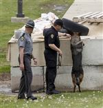 A-bomb-sniffing-dog-and-law-enforcement-personnel-search-the-grounds-of-the-Toledo-Correctional-Institution