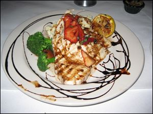 Grilled wild swordfish topped with strawberry chutney and balsamic glaze.