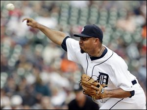 Detroit Tigers relief pitcher Joaquin Benoit throws against the Kansas City Royals in the ninth inning of a baseball game in Detroit.