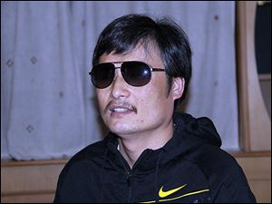 Blind Chinese legal activist Chen Guangcheng is seen at an undisclosed location in Beijing during an April meeting with human rights activists Hu Jia and Zeng Jinyan.