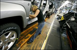 Pam Bialecki works on a 2012 Jeep Wrangler at the Chrysler Toledo Assembly complex in November.