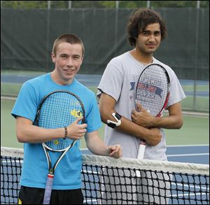 Ryan Brown, a sophomore, left, and Madhav Mehta, a senior, are 17-1 this season as the No. 1 doubles team for the Titans.