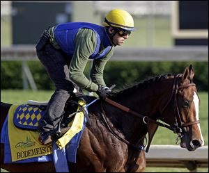 Exercise rider George Alvarez takes Kentucky Derby entrant Bodemeister for a workout Wednesday at Churchill Downs.
