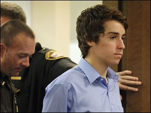 Thomas 'T.J.' Lane enters a hearing in Chardon, Ohio, Wednesday. The 17-year-old was found mentally competent for juvenile court proceedings. He is accused of killing three people and wounding two.
