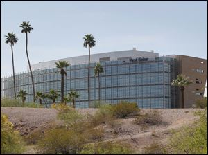 First Solar Inc's corporate headquarters in Tempe, Ariz. First Solar Inc will lay off 2,000 workers and close it's factory in Germany following a collapse in solar panel prices.