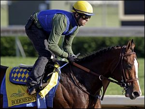 Exercise rider George Alvarez takes Bodemeister for a workout Wednesday at Churchill Downs.