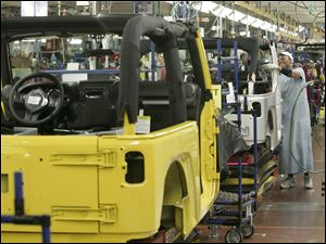 Workers building the Jeep Wrangler in Toledo are expected to get a couple of extra paychecks this year without the summertime pause.