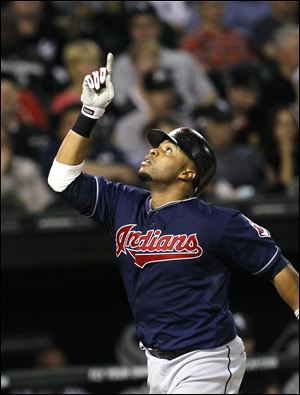 Carlos Santana celebrates his three-run home run to help give Cleveland the lead in the fifth inning Wednesday night.