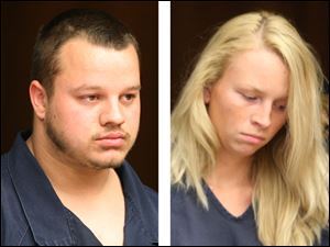 Joshua Waxler, left, and Courtney Waxler are arraigned Thursday in Toledo Municipal Court.