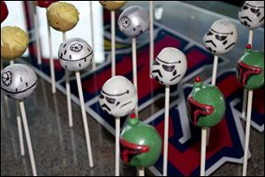 Star Wars cake pops are on hand to help celebrate.