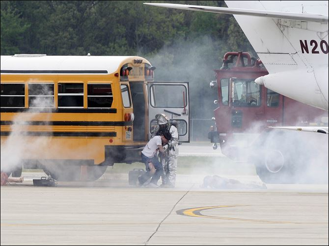 Disaster drill at the airport draws scores of responders A school bus was a prop, substituting for a passenger plane, in a disaster drill at Toledo Express Airport.  Federal law requires a disaster drill at least every three years at the western Lucas County airport.