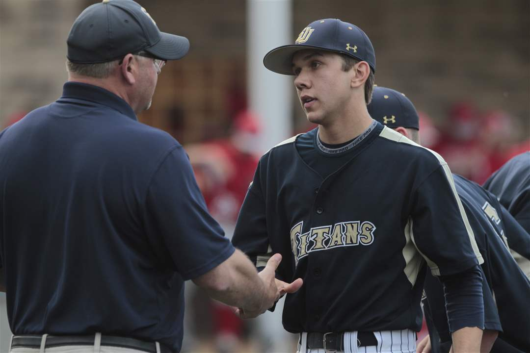St-John-s-asst-coach-Doug-Pearson-left-shakes-hand-of-pitcher-Jesse-Adams