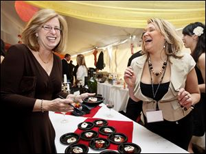 Barb Yavorcik, left, and Julie Kiyas of Zia's, share a laugh.