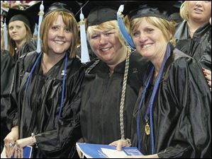Early Childhood Education graduates Jennifer Johnides, 41, of Celina; Sue Stachler, 53, also of Celina; and Kathy Fleagle, 52, of St. Mary's, Ohio.   A capacity crowd celebrated the graduations of University of Toledo Associates, Bachelors, Masters, and Doctoral degrees candidates at the university in Toledo, Ohio on May 5, 2012.