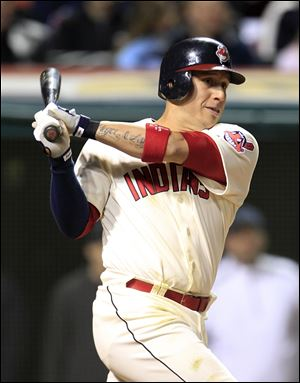 The Indians' Asdrubal Cabrera hits an RBI-double off Rangers relief pitcher Mike Adams in eighth inning.