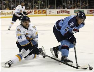 The Walleye's Sal Peralta, left, battles Charlotte's Mike Bartlett in an ECHL game April 7, 2010, at the Huntington Center. The Checkers moved to the American Hockey League the next season.