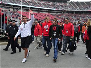 Ohio State Buckeyes head coach Urban Meyer waves to fans as he walks off the field after the Ohio State Buckeyes Scarlet vs Grey spring game.