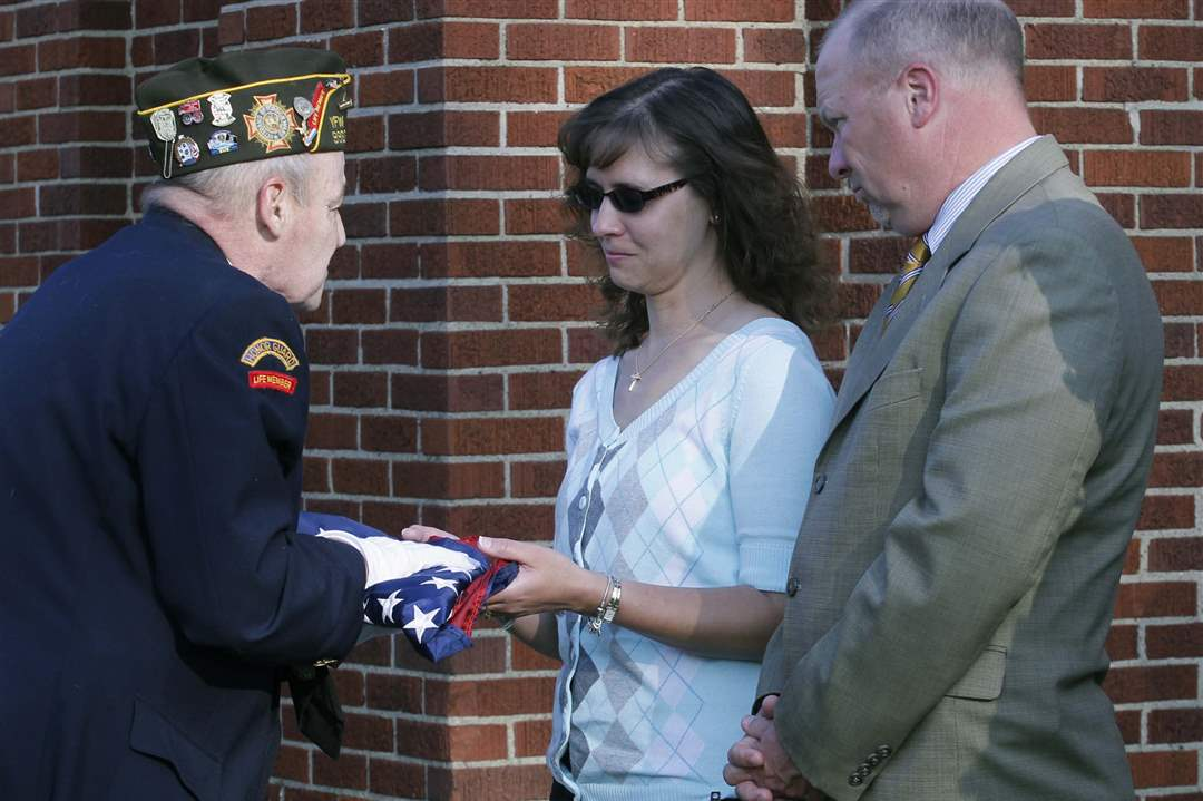 VFW-9963-commander-Jim-Dolan-presents-the-flag-that-flew-outside-of-the-school