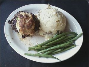 Rockwell's Surf and Turf includes a 7-ounce prime grade top sirloin served with a crab cake, mashed potatoes, and green beans.