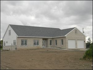 High school students from Penta Career Center buit this 2,200-square-foot home at 10663 Eckel Junction Rd. It is to be open for public viewing May 20 from 1 to 4 p.m.