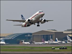 A Sukhoi Superjet-100 takes off from Halim Perdanakusuma airport in Jakarta, Indonesia, Wednesday, May 9, 2012 on it's second demonstration flight of the day. The Russian-made Sukhoi jet plane with 45 people on board, including eight Russians and an American, went missing during this flight near Jakarta, Indonesian government officials said Wednesday.
