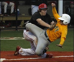 Bowsher pitcher Jacob Almanza stops Clay's Tyrus McAtee short of the plate in Wednesday's sectional final.