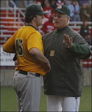 Clay assistant coach Rod Achter talks to pitcher Jordan Grosjean, who struck out14 batters.