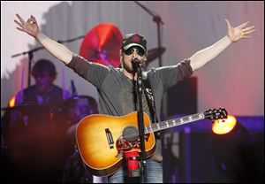 Singer Eric Church welcomes the Toledo-area crowd to his show at the Huntington Center Thursday night.