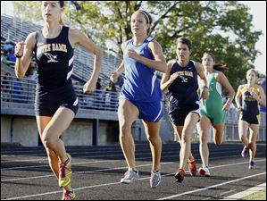 Francesca Veluscek of Notre Dame wins the 1600 meter run during the Three Rivers Athletic Conf