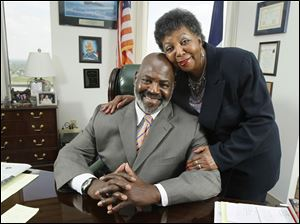 Mayor Mike Bell poses in his office with his mother, Ora Bell.